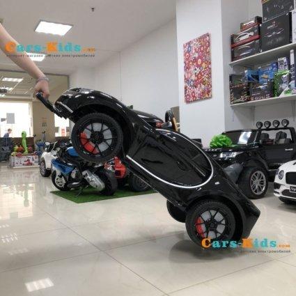 Электромобиль Bugatti Chiron HL318 белый (колеса резина, кресло кожа, пульт, музыка)